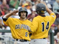 California's Derek Campbell, left, celebrates with Tony Renda after scoring against Texas A&M in the fifth inning of the Bears' 7-3 victory at the College World Series in Omaha.