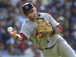 Cardinals' Daniel Descalso, fielding a bunt in a game in May, has helped the club stay in contention.