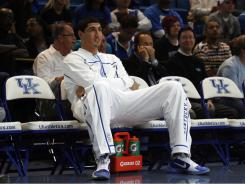Enes Kanter watches the Kentucky Wildcats practice during Midnight Madness at Rupp Arena last season. Kanter was ruled ineligible by the NCAA.