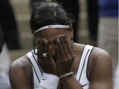Serena Williams of the USA shows her emotions following her 6-3, 3-6, 6-1 first-round victory against Aravane Rezai of France on Tuesday at Wimbledon.