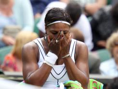 Serena Williams shows her emotions after her first-round victory Tuesday at Wimbledon.