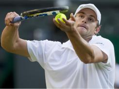 Andy Roddick serves up a straight-sets victory against Victor Hanescu in the second round of Wimbledon on Wednesday.