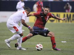 Clint Dempsey (8), seen here stealing the ball from Roman Torres during the CONCACAF Gold Cup semifinal game in Houston, scored the only goal in the USA's 1-0 win over Panama.