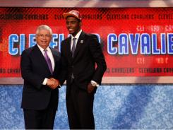 Duke guard Kyrie Irving greets NBA Commissioner David Stern after he was selected No. 1 overall by the Cleveland Cavaliers at the NBA Draft in Newark.