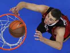 Lithuania's Jonas Valanciunas, above, drafted fifth overall by the Raptors, could join Andrea Bargnani to form a formidable frontline.