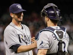 Rays pitcher James Shields, left, and catcher Kelly Shoppach celebrate after Tampa Bay's win over the Astros at Minute Maid Park.
