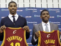 The Cavaliers' rebuilding plan began with Thursday night's draft. The team introduced Tristan Thompson, left, and Kyrie Irving to Cleveland on Friday.