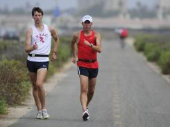 Trevor Barron (left) and his coach Tim Seaman enjoy a training race walk in San Diego. Barron hopes to qualify for the 2012 London Games.