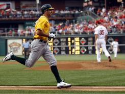 The Athletics' Adam Rosales rounds the bases after hitting a home run off Phillies pitcher Cole Hamels. The A's have hit an AL-worst 41 homers in 2011.