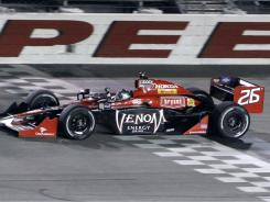 Marco Andretti crosses the finish line to win the Iowa Corn Indy 250 auto race Saturday, his first win in five years.
