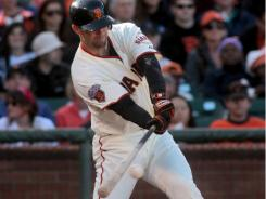 Giants catcher Chris Stewart hits a two-run double in the second inning against Cleveland, his first RBI hit since 2007.