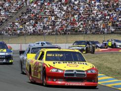 Kurt Busch, front, led the pack for most of the day at Infineon Raceway in Sonoma, Calif.