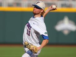Hudson Randall, who started Florida's College World Series opener vs. Texas, will get the call again Monday to open the title series against South Carolina.