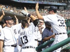 Don Kelly celebrates with his teammates after scoring on a Miguel Cabrera single in the eight inning.