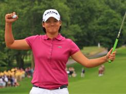 Yani Tseng of Taiwan celebrates her 10-stroke victory Sunday in the Wegmans LPGA Championship.