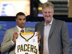 Indiana pacers president Larry Bird, right, poses with new Pacer guard George Hill after he was introduced Monday in Indianapolis.