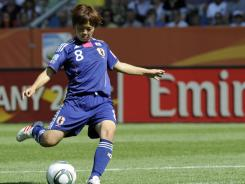 Japan's Aya Miyama scores the winning goal on a free kick against  New Zealand at the Women's World Cup in Bochum, Germany on Monday. Japan won 2-1.