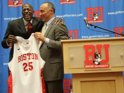 Joe Jones smiles as he is introduced as Boston University's new basketball coach by athletics director Mike Lynch.