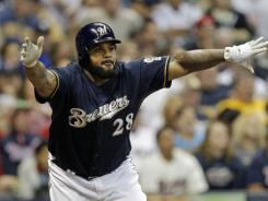 Brewers' Prince Fielder reacts after hitting a two run-scoring double during the seventh inning against the Twins.