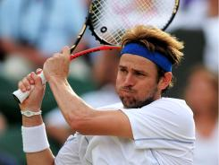 Mardy Fish of the USA downed 2010 runner-up Tomas Berdych of the Czech Republic on Monday to reach the quarterfinals at Wimbledon for the first time.