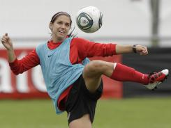 Alex Morgan shoots during a training session. The U.S. plays North Korea in its World Cup opener on Tuesday.