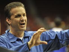 John Calipari signed an eight-year extension with the University of Kentucky on Monday.