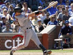 Aaron Rowand hit a bases-loaded double in the fifth inning of the Giants' 13-7 win over the Cubs in the first game of a day-night baseball doubleheader.