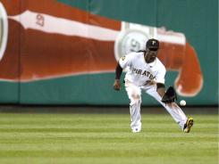 Pirates center fielder Andrew McCutchen fields a ball hit up the middle.