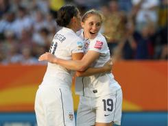Rachel Buehler, right, celebrates her second-half goal with Alex Krieger during the USA's 2-0 victory against North Korea to open the World Cup.