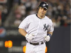 Teixeira hit a home run and had four RBI in the Yankees' 12-2 drubbing of the Brewers on Tuesday night.