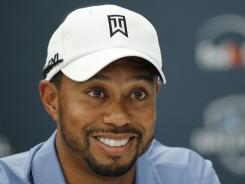Tiger Woods smiles during a news conference for the AT&T National at Aronimink Golf Club on Tuesdaya in Newtown Square, Pa.