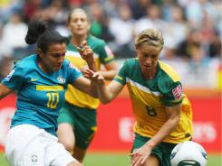 Marta (L) of Brazil is challenged by Elise Kellond-Knight of Australia during the World Cup   Group D match between Brazil and Australia on June 29 in Moenchengladbach, Germany.