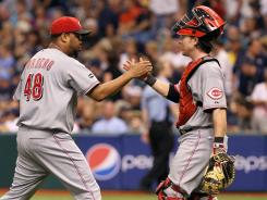 Reds relief pitcher Francisco Cordero, left,  reacts with catcher Ryan Hanigan after they beat the Rays.