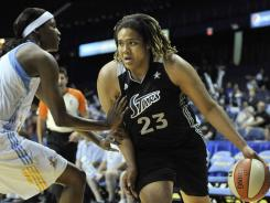 San Antonio Silver Stars forward Danielle Adams, right, drives on Chicago Sky forward Michelle Snow during their game in Rosemont, Ill.