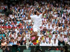 Jo-Wilfried Tsonga of France rises to the occasion in the quarterfinals Wednesday, rallying from two sets down to defeat six-time champion Roger Federer.