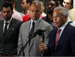 Derek Fisher, center, and union executive director Billy Hunter say NBA players oppose a hard salary cap but have proposed a $500 million reduction in salaries.