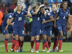 France's Elodie Thomis, third right, is congratulated by teammates after scoring her side's fourth goal during the group A match between Canada and France at the World Cup in Bochum, Germany, on June 30.