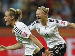 Germany's Simone Laudehr, left, celebrates her goal with Alexandra Popp during their Group A match against Nigeria.