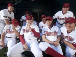 Diamondbacks pitcher J.J. Putz, center, is surrounded by the entire bullpen.  The secret of their recent success is that the bullpen does not take themselves too seriously.  From left back row:   Aaron Heilman, Esmerling Vasquez, Micah Owings, Bullpen catcher Jeff Motuzas, bullpen coach Glenn Sherlock.  Front row: Bryan Shaw,  Putz, Joe Paterson, David Hernandez.