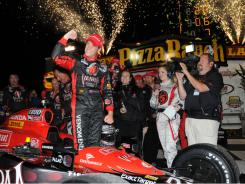 IndyCar driver Marco Andretti celebrates winning the Iowa Corn 250 on June 25.