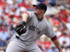 Red Sox pitcher Jon Lester allowed just two hits over seven scoreless innings.