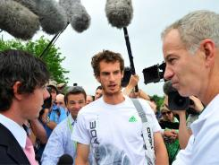 Golfer Rory McIlroy, left, meets tennis players Andy Murray, center, and John McEnroe (R) on Day Eight of the Wimbledon Championships.