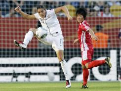 Ali Krieger, left,  controlling the ball against North Korea Tuesday, played four seasons for FFC Frankfurt.
