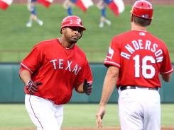 Nelson Cruz, left, hit his 19th homer of the season and drove in six on his 31st birthday.