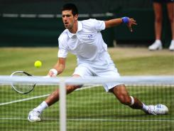 Novak Djokovic of Serbia cruises into the Wimbledon final, and claims the No. 1 ranking, with a victory against  Jo-Wilfried Tsonga of France on Friday.