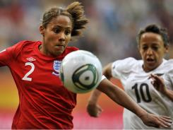 England defender Alex Scott, left, and New Zealand striker Sarah Gregorius vie for the ball during the Group B soccer match at the Women's World Cup. England won 2-1.