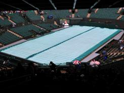 Rain delayed play at Court 1, which could get a roof.