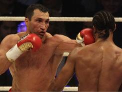 IBF, WBO, IBO  world champion  Wladimir Klitschko fights with WBA world champion David Haye of Britain in heavyweight unification fight in the stadium in Hamburg, Germany on Saturday.
