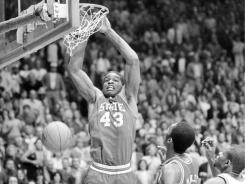 Lorenzo Charles' dunk gave N.C. State a 54-52 win over Houston in the 1983 NCAA Championship game. He died in a bus accident on Monday.