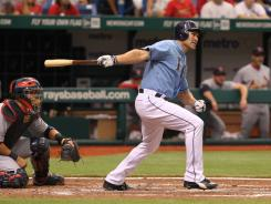 Designated hitter Johnny Damon had three hits and four RBI in the Rays' 8-3 win over the Cardinals on Sunday.